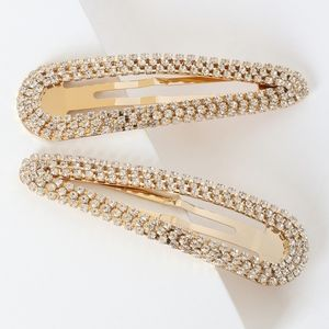 Lulu's | Gold Toned Rhinestone Hair Clip Set